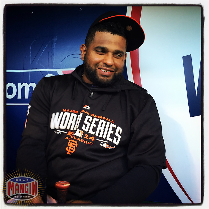 KANSAS CITY, MO - OCTOBER 29: Instagram of Pablo Sandoval of the San Francisco Giants sitting in the dugout before Game 7 of the World Series against the Kansas City Royals at Kauffman Stadium on October 29, 2014 in Kansas City, Missouri. Photo by Brad Mangin