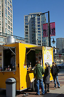 People ordering at a vegan food truck in Yaletown, Vancouver, British Columbia, Canada.