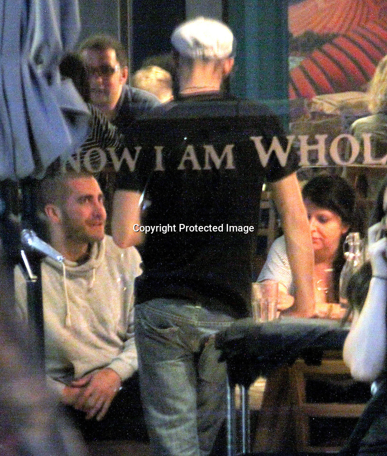 July 9th 2011  Exlusive ..Jake Gyllenhaal sporting a newly shaved head eating dinner with an older lady at a restaurant called Café Gratitude in Los Angeles. Jake was inside text messaging on his phone, talking with fans & a very deep conversation with his date for about 2 hours. Jake loves to talk. Jake picked up the bill & looked a little concerned with the tab. ...AbilityFilms@yahoo.com.805-427-3519.www.AbilityFilms.com...