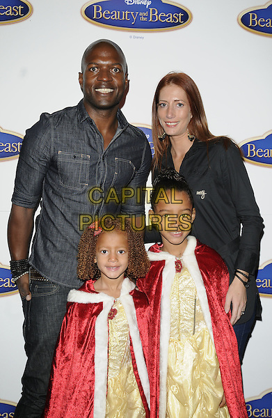 """KEVIN ADAMS & FAMILY .At Disney's """"Beauty And The Beast"""" gala screening, Cafe de Paris, London, England, UK, September 26th 2010..half length daughters kids children wife denim shirt dressed up costume princess .CAP/CAN.©Can Nguyen/Capital Pictures."""
