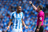 Mathias Zanka of Huddersfield Town disagrees with Referee Michael Olivers call during the Premier League match between Huddersfield Town and Arsenal at the John Smith's Stadium, Huddersfield, England on 13 May 2018. Photo by Thomas Gadd / PRiME Media Images.