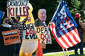 Protestors await United States President Donald J. Trump's motorcade outside the Trump National Golf Club in Herndon, Virginia on Sunday, September 20, 2020.  <br /> Credit: Chris Kleponis / Pool via CNP
