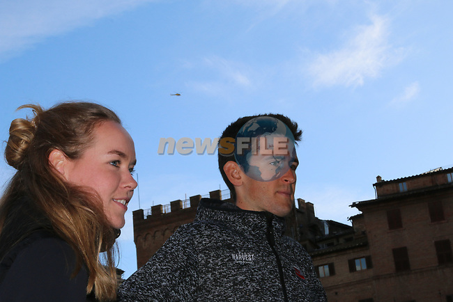 Last year's winners Tiesj Benoot (BEL) Lotto-Soudal and World Champion Anna Van der Breggen (NED) Boels Dolmans pose for pictures in Il Campo Siena finish line of the 2019 Strade Bianche running 184km from Siena to Siena, held over the white gravel roads of Tuscany, Italy. 8th March 2019.<br /> Picture: Seamus Yore | Cyclefile<br /> <br /> <br /> All photos usage must carry mandatory copyright credit (© Cyclefile | Seamus Yore)