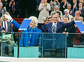 United States President George H.W. Bush and first lady Barbara Bush wave prior to his delivering the Inaugural Address after being sworn-in as 41st President of the United States at the US Capitol on January 20, 1989. Visible at right is former US President Ronald Reagan.<br /> Credit: Louis Jacobson  / CNP