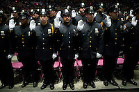 29 December 2005 - New York City, NY - Recruits belonging to the New York Police Department's Class of 2005 are sworn in during their graduation ceremony, 29 December 2005, in New York City. 1,735 recruits were sworn in during the ceremony.