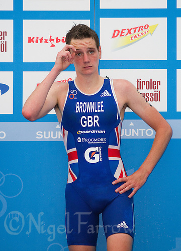 24 JUN 2012 - KITZBUEHEL, AUT - Alistair Brownlee (GBR) of Great Britain waits for the start of the medal ceremony after winning the elite men's 2012 World Triathlon Series round in Schwarzsee, Kitzbuehel, Austria (PHOTO (C) 2012 NIGEL FARROW)