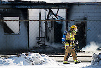 Bay City fire fighters respond to a blaze that engulfed the heat treating building Friday, Jan. 30, 2015 at Bay Carbon Inc. on Marquette Avenue in Bay City's West Side.