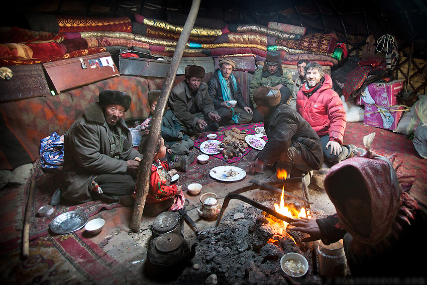 Matthieu Paley with Kyrgyz friend in a yurt..The veil celebration: before moving to her new husband's camp, Ikhbal, a recently married Kyrgyz girl, will exchange the red veil of the unmarried girl for the white veil signifying that she is now a married woman...The Kyrgyz settlement of Ech Keli, above Chaqmaqtin lake, Er Ali Boi's camp...Trekking through the high altitude plateau of the Little Pamir mountains, where the Afghan Kyrgyz community live all year, on the borders of China, Tajikistan and Pakistan.