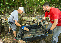 NWA Democrat-Gazette/BEN GOFF @NWABENGOFF<br /> John Varvil (left), of Springdale and Jared Faust of Fayetteville volunteer with Ozarks Off Road Cyclists to add rock armoring Saturday, July 6, 2019, at the intersection of Last Call and Terrapin Station at Kessler Mountain Regional Park in Fayetteville. Volunteers used 11 tons of stone to shore up the often muddy and erosion-damaged section of the trail and recently completed similar projects on other trails at the park. The Ozark Off Road Cyclists, the local chapter of the International Mountain Bicycling Association, are raising funds through their Kessler Campaign to fund further improvements and future trails at the park.