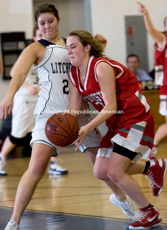 LITCHFIELD, CT - 09 FEBRUARY 2009 -020909JT07-<br /> Northwestern's Sarah Raftery dribbles past Litchfield's Kathleen Lavoie during Monday's game at Litchfield in which Northwestern won, 49-46.<br /> Josalee Thrift / Republican-American