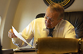 United States Secretary of Defense Donald Rumsfeld catches up on paperwork en route to Iraq and Afghanistan on September 3, 2003.  <br /> Mandatory Credit: Andy Dunaway / DoD via CNP