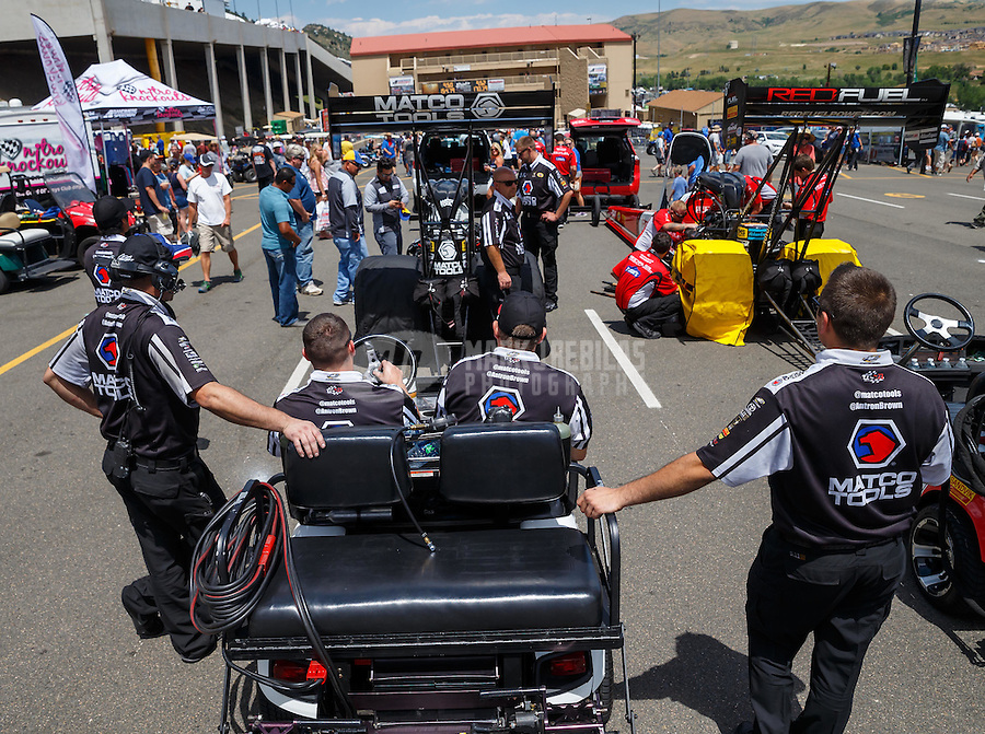 Jul 24, 2016; Morrison, CO, USA; Crew members with NHRA top fuel driver Antron Brown during the Mile High Nationals at Bandimere Speedway. Mandatory Credit: Mark J. Rebilas-USA TODAY Sports