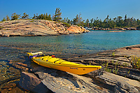 Kayak on Precambrian shield rock along shoreline of Georgian Bay<br />