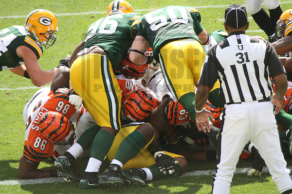 GREEN BAY - SEPTEMBER 2009:  Carson Palmer (9) of the Cincinnati Bengals dives into the endzone against the Green Bay Packers during a game on September 20, 2009 at Lambeau Field in Green Bay, Wisconsin. (Photo by Brad Krause)