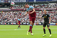 Declan Rice of West Ham United heads during the Premier League match between West Ham United and Manchester City at the London Stadium, London, England on 10 August 2019. Photo by David Horn.