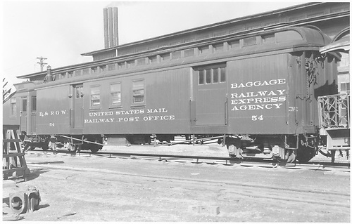 #54 combined baggage &amp; RPO car at Alamosa.  Angled side view.<br /> D&amp;RGW  Alamosa, CO  Taken by Richardson, Robert W. - 9/29/1949
