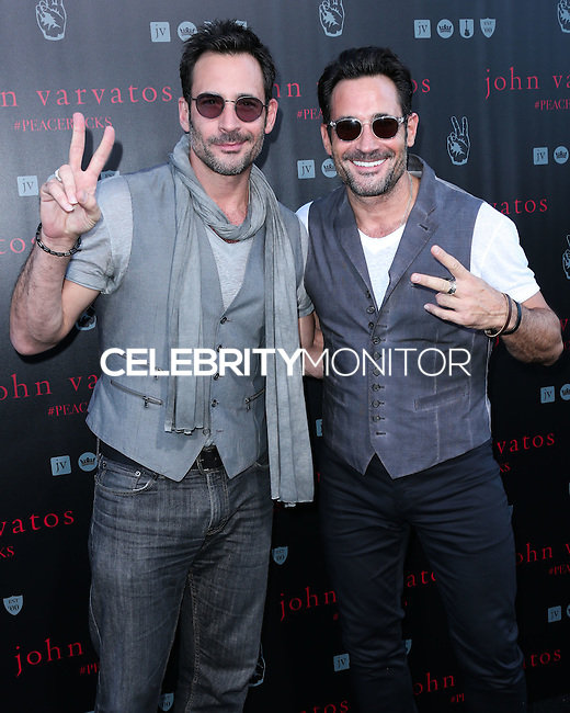WEST HOLLYWOOD, CA, USA - SEPTEMBER 21: Lawrence Zarian, Gregory Zarian arrive at the John Varvatos #PeaceRocks Ringo Starr Private Concert held at the John Varvatos Boutique on September 21, 2014 in West Hollywood, California, United States. (Photo by Xavier Collin/Celebrity Monitor)