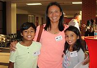 NWA Democrat-Gazette/CARIN SCHOPPMEYER Chin Bee Khoo, Hall of Honor inductee, and her children, Hayden and Hayley, enjoy the VIP reception.