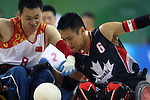 Ian Chan of Surrey, B.C. battles for the ball with Shuangmiao Cheng of China in wheelchair rugby action at the Paralympic Games in Beijing, Saturday, Sept., 13, 2008.  Photo by Mike Ridewood/CPC