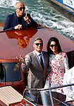 George Clooney and Amal Alamuddin pass under the Academia bridge on September 28, 2014 to go to brunch the day after they get married.<br /> Photo / Pierre TEYSSOT