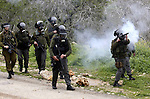 Israeli soldiers fire tear gas canisters towards Palestinian protesters during a demonstration against the expropriation of Palestinian land by Israel in the village of Kfar Qaddum, near the West Bank city of Nablus, on March 2, 2012.  Photo by Wagdi Eshtayah