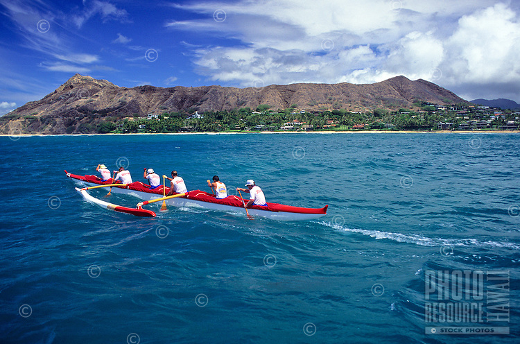 Outrigger canoe racing; Outrigger Canoe Club Men's crew, Men's Lanikai Race; Kahala, Oahu, Hawaii..Diamond Head in background