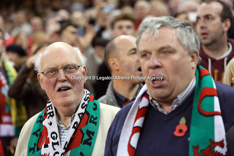 Pictured: Two men singing the welsh anthem. Saturday 08 November 2014<br /> Re: Dove Men Series rugby, Wales v Australia at the Millennium Stadium, Cardiff, south Wales, UK.