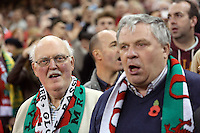 Pictured: Two men singing the welsh anthem. Saturday 08 November 2014<br />