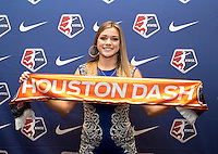 #2 overall pick Kealia Ohai of the Houston Dash poses with her team scarf during the NWSL draft at the Pennsylvania Convention Center in Philadelphia, PA, on January 17, 2014.
