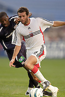 D.C. United's Ben Olsen attempts to get past the New England Revolution's Avery John. The New England Revolution and D.C. United finished in a scoreless tie in MLS play at Gillette Stadium, Foxboro, MA on Saturday August 28, 2004.