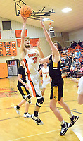Westside Eagle Observer/MIKE ECKELS<br /> <br /> Brayden Trembly (Lions 33) puts up a jumper over the arms of Jake Webb (Tiger 44) during the fourth quarter of the Gravette-Prairie Grove conference game in the competition gym Jan. 14.