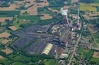 Asse 2  Foerderturm des Bergwerks und Atomlagerstaette: DEUTSCHLAND, NIEDERSACHSEN, REMLINGEN, (GERMANY), 02.11.2014:Es wurde ab Juli 1981 errichtet und hatte ursprünglich eine Leistung von 808 Megawatt, seit der Revision 2009 von 848 Megawatt. Das Kraftwerk mit seinem 275 Meter hohen Kamin ging am 19. Juni 1985 in Betrieb und ist ein Grund- und Mittellastkraftwerk.<br /> <br /> Versorgt wird das Kraftwerk hauptsächlich mit Anthrazitkohle aus der benachbarten Zeche Ibbenbüren im Tecklenburger Land. Diese Kohle ist sehr hart und macht eine Schmelzkammerfeuerung notwendig. Der Kessel des Kraftwerks in Ibbenbüren ist der größte Schmelzkammerkessel der Welt (Stand 2005). Jährlich werden circa 1,4 Mio. Tonnen Anthrazitkohle im Kraftwerk verstromt.<br /> <br /> Ende der 1980er Jahre wurde das Kraftwerk mit der zu diesem Zeitpunkt modernsten Filtertechnik und Anlagen zur Rauchgasentschwefelung ausgerüstet. Das Kraftwerk beschäftigt derzeit 140 Menschen. Der Betreiber des Kraftwerks ist die RWE Generation SE.