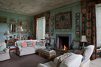 The cheerful morning room still retains the same paintwork from after World War I. John Merton's portrait of his mother, then Countess of Dalkeith, hangs above the fireplace