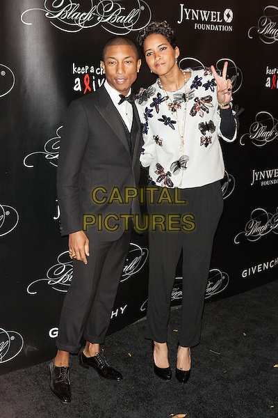 NEW YORK, NY - NOVEMBER 7, 2013: Pharrell Williams, Helen Lasichanh at Keep A Child Alive's 10th Annual Black Ball at Hammerstein Ballroom on November 7, 2013 in New York City.<br /> CAP/MPI/COR<br /> &copy;Corredor99/ MediaPunch/Capital Pictures