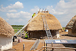 Buildings of replica Neolithic huts at the Stonehenge site, Wiltshire, England, UK