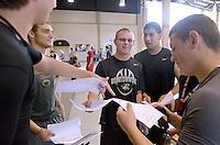 NWA Democrat-Gazette/BEN GOFF &bull; @NWABENGOFF<br /> Alex Bushong (from left) Braxton Parnell, Aaron Scott, Jerry Silva and Jacob Clark, all junior football players, compare their schedules on Thursday Aug. 6, 2015 during student schedule pickup at Bentonville High School. Bentonville High and other traditional-schedule schools in the district resume classes on Tuesday, Aug. 18.