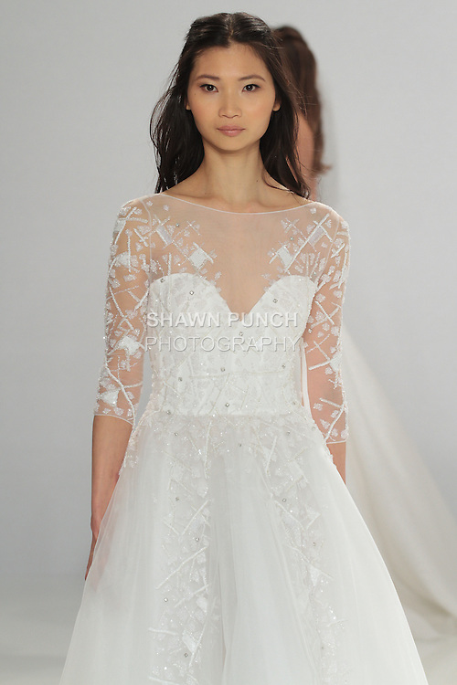 "Model walks runway in Shella - an off white tulle dress embellished with patchwork embroidery assembled on the bodice and a full skirt, from the Tony Ward Fall 2016 ""A Mid-Summer Night's Dream"" bridal collection on April 18, 2016 at Kleinfeld Bridal during New York Bridal Fashion Week Spring Summer 2016."