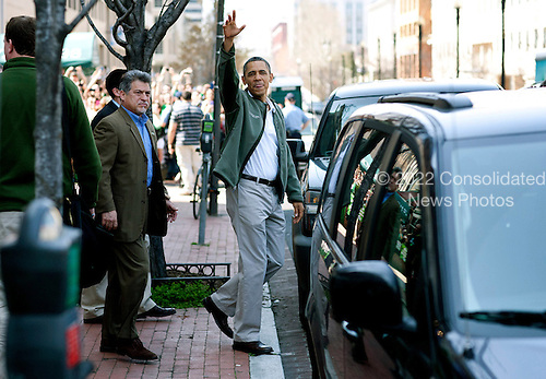 United States President Barack Obama waves as he leaves a bar in celebration of St. Patrick's day at the Dubliner Restaurant and Pub on March 17, 2012 in Washington, DC. Next week, Obama and Vice President Biden will meet the Irish Prime Minister Enda Kenny and attend a St. Patrick's Day lunch at the Capitol. .Credit: Joshua Roberts / Pool via CNP