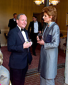 William Kristol, left, and Arianna Huffington, right, share some thoughts as they attend one of the receptions prior to the 1999 White House Correspondents Dinner at the Washington Hilton Hotel in Washington, D.C. on May 1, 1999..Credit: Ron Sachs / CNP.
