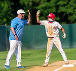 WATERBURY,  CT-072719JS32-- D-Bat's Alejandro Mendoza (2) gets a high-five from his coach after hitting an RBI triple during their Mickey Mantle World Series game against Cyclones Ponce (Puerto Rico) Saturday at Municipal Stadium in Waterbury.  <br /> Jim Shannon Republican-American