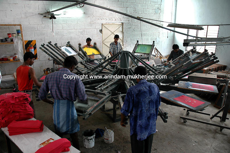 A silk screen printing unit for garments owned by Popy's industries in Tirupur, Tamilnadu. After lifting of quota system in textile export on 1st january 2005. Tirupur has become the biggest foreign currency earning town of India.