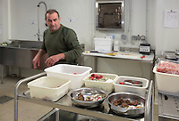Alain Bessaguet, head zookeeper and head of feeding and lions, monitors and checks the food trays in the kitchens of the new Parc Zoologique de Paris or Zoo de Vincennes, (Zoological Gardens of Paris or Vincennes Zoo), which reopened April 2014, part of the Musee National d'Histoire Naturelle (National Museum of Natural History), 12th arrondissement, Paris, France. Picture by Manuel Cohen