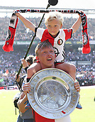 May 14th 2017, Rotterdam, Netherlands;  Feyenoord Rotterdam s Dirk Kuyt celebrates with his son after the Dutch Eredivisie match between Feyenoord Rotterdam and Heracles Almelo in Rotterdam, the Netherlands, May 14, 2017.  This was Kuyt last game for his club before retiring from the game.