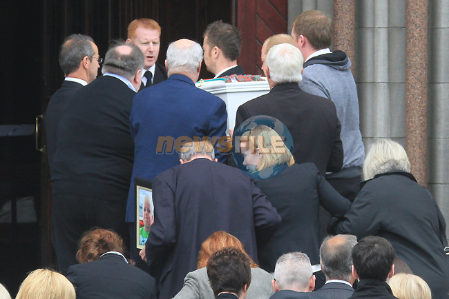 The Funeral of 4 year old conor McDaid at St Marys Church in Drogheda.Mother Mary McDaid and Her Father holding picture of Conor..Picture Fran Caffrey www.newsfile.ie