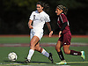 Katherine Galzerano #5 of Garden City, left, passes upfield as Donatella Tocco #9 of North Shore puts pressure on her during a Nassau County Class A varsity girls soccer quarterfinal at Garden City High School on Wednesday, Oct. 26, 2016. Garden City won by a score of 1-0.
