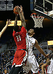 UNLV's Goodluck Okonoboh (11) gets fouled by Nevada's AJ. West (3) during a college basketball game in Reno, Nev., on Tuesday, Jan. 27, 2015. The Rebels won 67-62. (Las Vegas Review-Journal/Cathleen Allison)