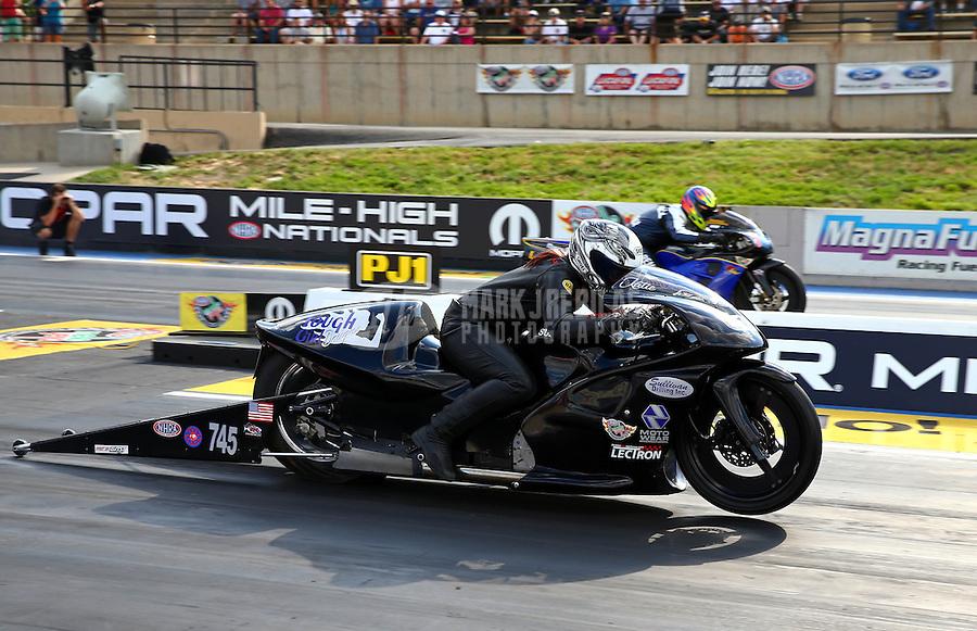 Jul. 19, 2013; Morrison, CO, USA: NHRA pro stock motorcycle rider Katie Sullivan during qualifying for the Mile High Nationals at Bandimere Speedway. Mandatory Credit: Mark J. Rebilas-