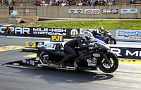 Jul. 19, 2013; Morrison, CO, USA: NHRA pro stock motorcycle rider Katie Sullivan during qualifying for the Mile High Nationals at Bandimere Speedway. Mandatory Credit: Mark J. Rebilas-