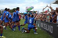 Samoa celebrates winning the fifth place playoff on day two of the 2018 HSBC World Sevens Series Hamilton at FMG Stadium in Hamilton, New Zealand on Sunday, 4 February 2018. Photo: Shane Wenzlick / lintottphoto.co.nz