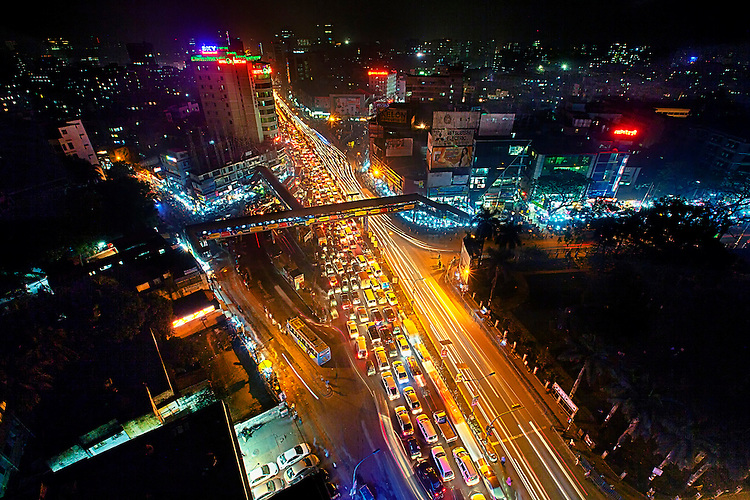 The streaks of light are created as vehicles move on the right side of the road while the other side halts due to a traffic jam in Dhaka, Bangladesh.
